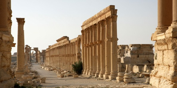 Along the Cardo Maximus or main street, 1.2 kms in length with porticoes at each end, 2nd century AD, Palmyra, Syria. Monumental arch in the distance. In Roman city-planning, the Cardo Maximus runs north-south, intersecting with the east-west Decumanus Maximus Picture by Manuel Cohen