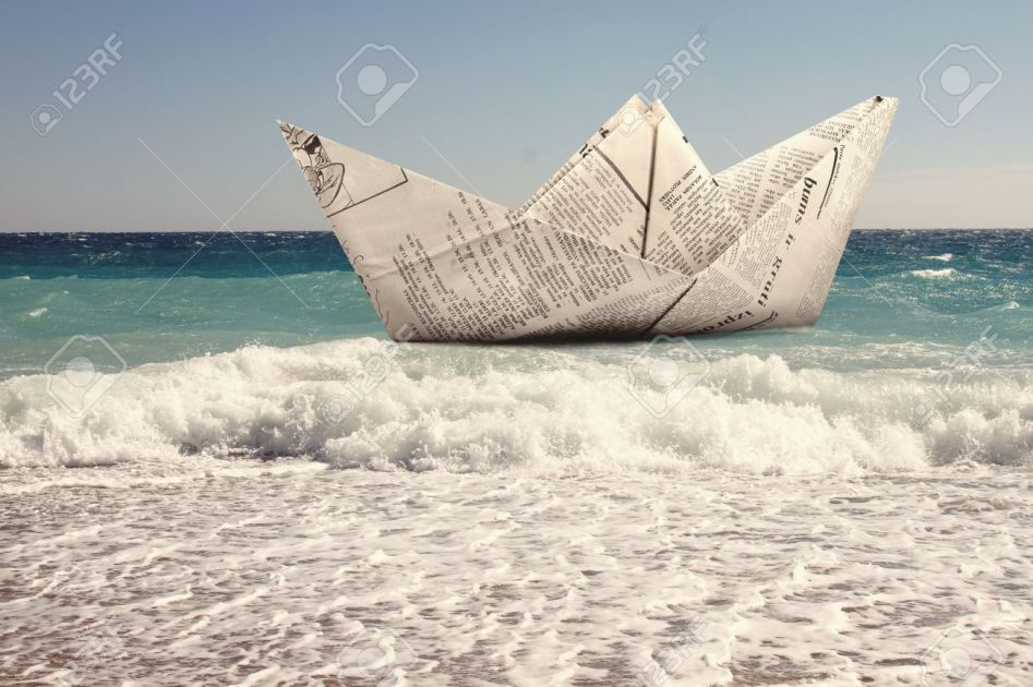 paper boat floating in a sea